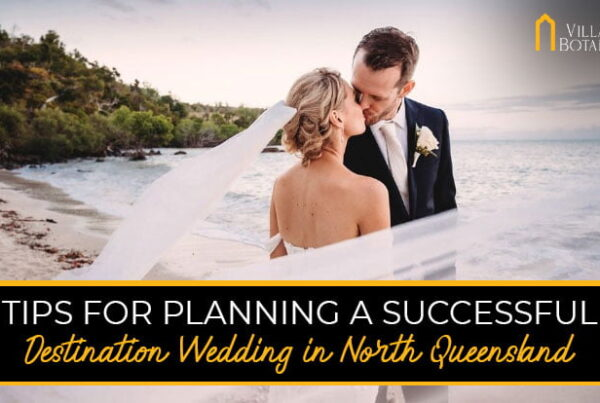 "a banner image of newly-wedded couple kissing with a banner text ""Tips For Planning A Successful Destination Wedding In North Queensland"""